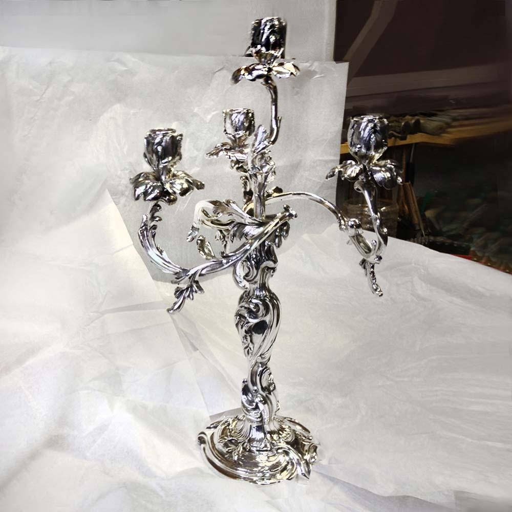 Orfèvre restaurateur de chandeliers anciens en argent ou métal argenté à Paris